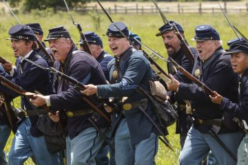 The Mifflin Guard Infantry, volunteer Civil War reenactors, portray Federal soldiers at the battle of Gettysburg on the 153 anniversary of Civil War conflict, at the Gettysburg National Military Park in Pennsylvania, Saturday, July 2, 2016. (AP Photo/J. Scott Applewhite)