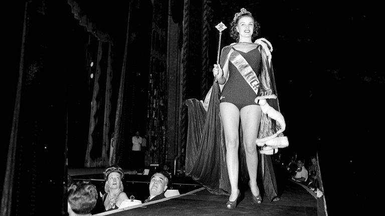 Venus Ramey, 19, of Washington, D.C., holds a scepter and wears the crown symbolic of her victory in the Miss America beauty pageant in Atlantic City, N.J., Sept. 9, 1944. She was entered in the contest as Miss Washington, D.C. (AP Photo/BB)