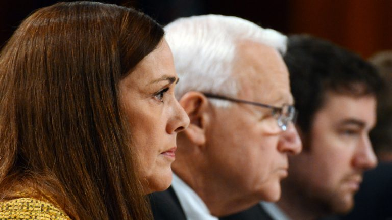 Pennsylvania Sens. Lisa Baker and Gene Yaw, center, listen during the first public hearing of a special Pennsylvania Senate committee set up to determine whether to seek removal proceedings against Attorney General Kathleen Kane Monday. (AP photo/Marc Levy)