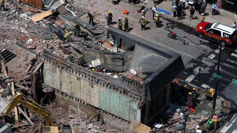 After the 2013 collapse, rescue personnel work the scene on Market Street in downtown Philadelphia that left six people dead. General contractor Griffin Campbell is standing trial on third-degree murder charges in the deaths of six people who perished in the collapse. (AP file photo)