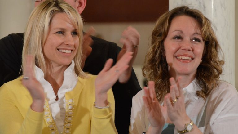 Mama bears Christine Brann (left) of Hummelstown and Angela Sharrer of New Oxford applaud lawmakers in the Pennsylvania Capitol after the state House of Representatives voted to send medical marijuana legislation to Gov. Tom Wolf's desk. They each  have a child who suffers from a severe form of epilepsy that they believe can be helped by a marijuana oil extract that is soon to be legal in Pennsylvania. (AP Photo/Marc Levy)