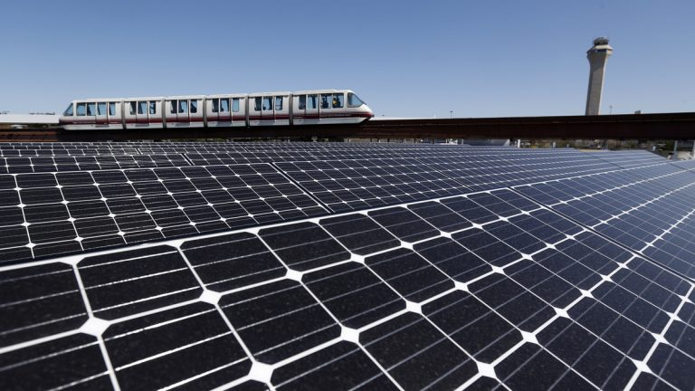 Solar panels on the roof of the building supplying energy to the AirTrain at Newark Liberty International Airport soak up the rays. A New Jersey lawmaker wants the state to aim for 80 percent renewable energy use by 2050. (AP file photo)