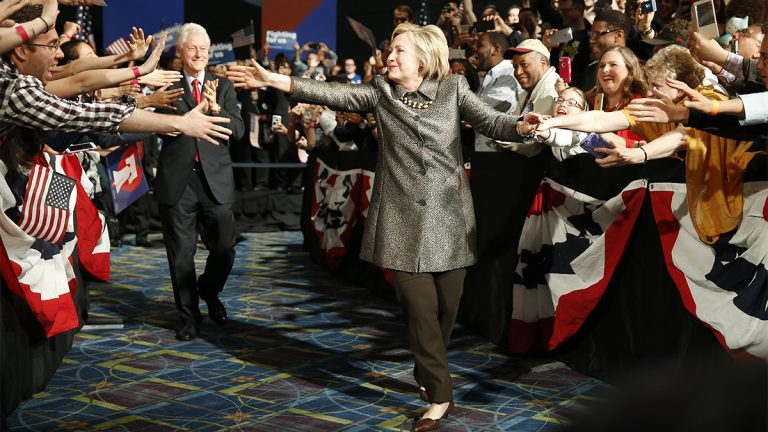 Democratic presidential candidate Hillary Clinton and Former President Bill Clinton move to the stage at her presidential primary election night rally