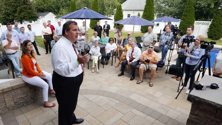 Republican presidential candidate New Jersey Gov. Chris Christie talks to supporters in the backyard of a house party in Salem, New Hampshire, last week as his wife, Mary Pat, left, looks on. (Winslow Townson/AP Photo)