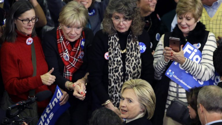 Hillary Clinton is surrounded by women who support her candidacy during a campaign stop in New Hampshire last month. A new poll finds men in New Jersey appear to be uncomfortable with the thought of a female president. (AP Photo/Elise Amendola)