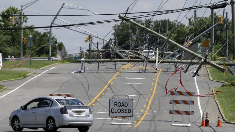 A driver turns her car at a closed road Wednesday after a violent storm downed poles and power lines Tuesday night in Gibbstown, New Jersey. Gloucester, Camden, Burlington and Salem counties saw the most damage from the ferocious storms that barreled through the region Tuesday night. (Mel Evans/AP Photo)