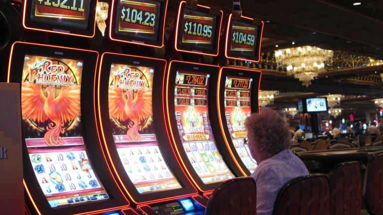 A gambler tries her luck at the slot machines at the Trump Taj Mahal casino in Atlantic City