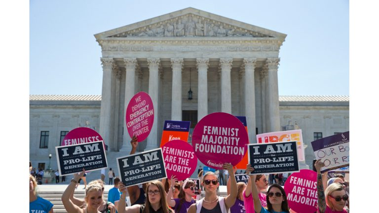 Demonstrators on both sides of the abortion issue stand in front of the Supreme Court in Washington Monday as the court announced several decisions. (Alex Brandon/AP Photo)