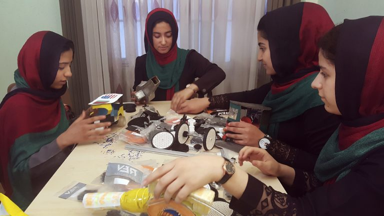 In this Thursday, July 6, 2017, file photo, teenagers from the Afghanistan Robotic House, a private training institute, practice at the Better Idea Organization center, in Herat, Afghanistan. U.S. President Donald Trump intervened to allow the group of Afghan girls into the country to participate in a robotics competition. (Ahmad Seir/AP Photo, file)
