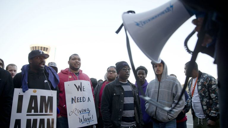 In this file photo, airport workers and their supporters picket, Thursday, April 2, 2015, at Philadelphia International Airport in Philadelphia.  (Matt Rourke/AP Photo, file)