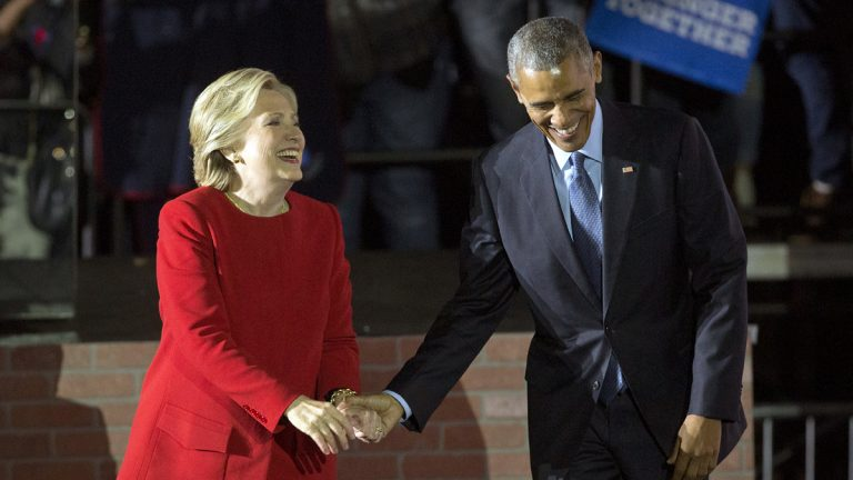 President Barack Obama and Democratic presidential candidate Hillary Clinton hold hands as they walk off stage after both spoke at a rally at Independence Mall in Philadelphia. Monday, Nov. 7, 2016. (Pablo Martinez Monsivais/AP Photo)