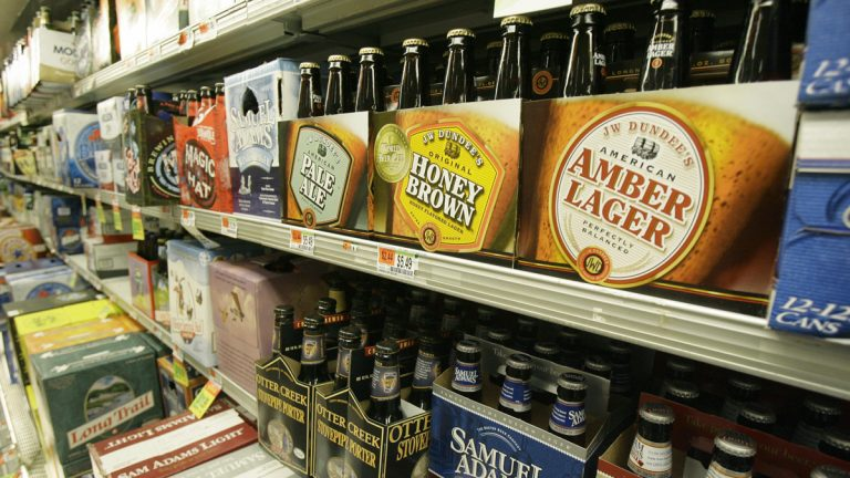 Various beer brands line store shelves. (Toby Talbot/AP Photo)
