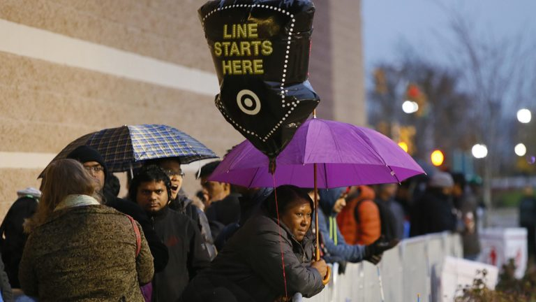 Guests wait for Black Friday sales before Target doors open at 6 p.m., Thursday, Nov. 24, 2016, in Jersey City, N.J. (Photo by Noah K. Murray/Invision for Target/AP Images)