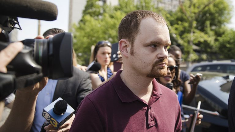 Brandon Bostian, the Amtrak engineer involved in a fatal train crash two years ago, walks to a police station in Philadelphia on Thursday, May 18, 2017, to turn himself in to answer charges including causing a catastrophe and involuntary manslaughter. (Matt Rourke/AP Photo)
