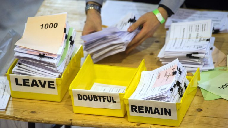 In this Friday, June 24, 2016 photo, votes are sorted into remain, leave and doubtful trays as ballots are counted during the EU Referendum count for Westminster and the City of London at the Lindley Hall in London. (Anthony Devlin/PA via AP, File)