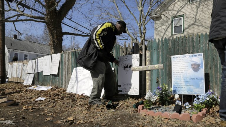 A man looks at signs near a memorial at the spot where Jerame Reid, was fatally shot by police in Bridgeton, N.J., Saturday, Feb. 28, 2015. A large group took part in a protest Saturday, which stemmed from the Dec. 30 shooting of Reid. The 36-year-old Bridgeton man was shot and killed by police during a traffic stop that was captured by a patrol car camera. (Mel Evans/AP Photo)