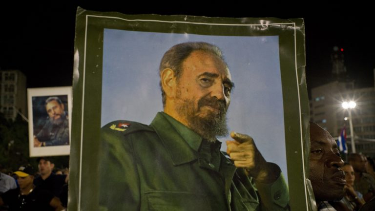 A picture of Fidel Castro is held during a rally honoring the late Cuban leader at the Revolution Plaza in Havana, Cuba, Tuesday, Nov. 29, 2016. Schools and government offices were closed Tuesday for a second day of homage to Fidel Castro, with the day ending in a rally on the wide plaza where the Cuban leader delivered fiery speeches to mammoth crowds in the years after he seized power. Fidel Castro passed away Friday Nov. 25. He was 90. (Ramon Espinosa/AP Photo)