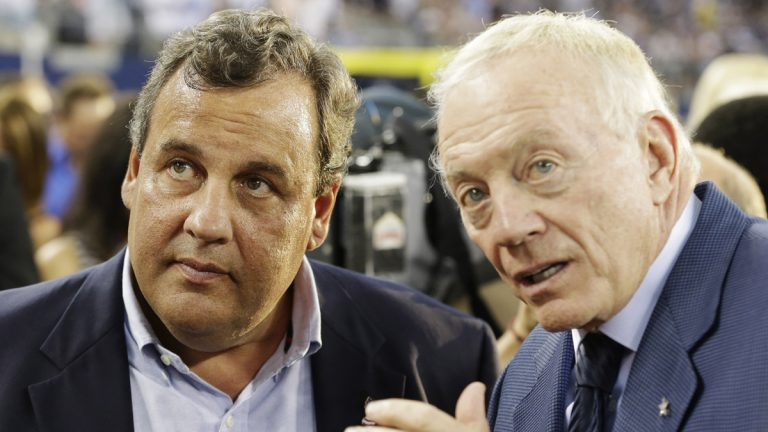 New Jersey Governor Chris Christie, left and Dallas Cowboys owner Jerry Jones talk before a NFL football game against the New York Giants Sunday, Sept. 8, 2013, in Arlington, Texas. (LM Otero/AP Photo)