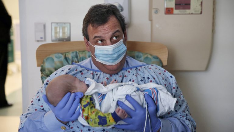 In this Tuesday, Dec. 6, 2016, file photo, New Jersey Gov. Chris Christie holds a 49-day-old baby boy being treated for neonatal drug withdrawal after his mother took opioids during pregnancy, at the Neonatal Intensive Care Unit at Jersey Shore University Medical Center in Neptune Township, N.J. (Mel Evans/AP Photo)