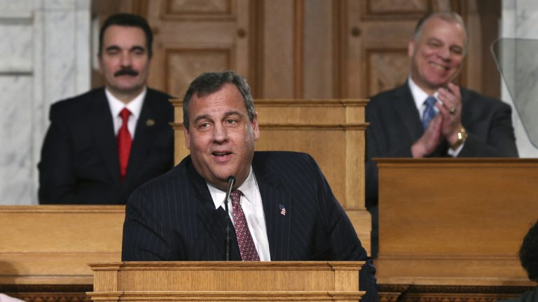 Vincent Prieto, (left), Speaker of the New Jersey General Assembly and Steve Sweeney, (right), New Jersey Senate President smile as New Jersey Gov. Chris Christie makes a joke about publishing a book, as he stands in the Assembly chamber of the Statehouse while delivering his State Of The State address Tuesday, Jan. 10, 2017, in Trenton, N.J. (Mel Evans/AP Photo)