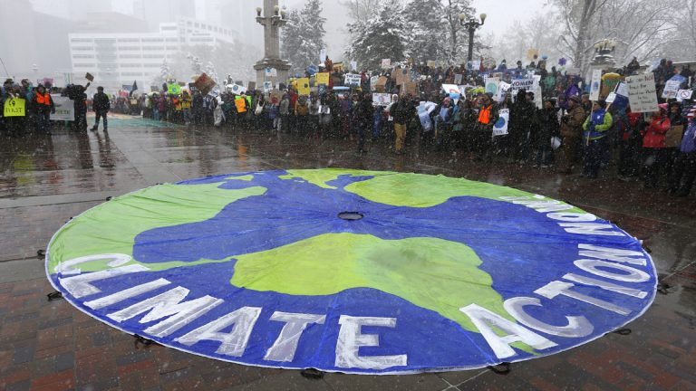 Participants chant during a climate change awareness rally, in Denver, Saturday, April 29, 2017. The gathering was among many others of its kind held nationwide marking President Donald Trump's 100th day in office. (Brennan Linsley/AP Photo)