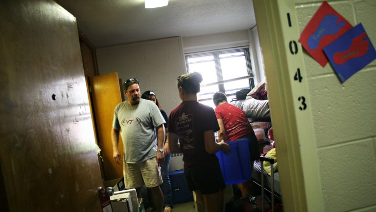In this file photo, students get help from their parents as they move into their dorm rooms on the first floor of Virginia Tech's West Ambler-Johnson dormitory in Blacksburg, Va., Aug. 15, 2007. (Christina O'Connor/AP Photo, file)