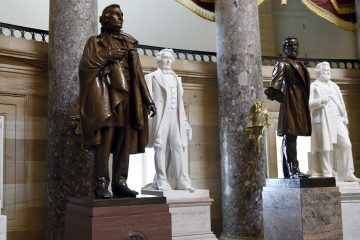 A statue of Jefferson Davis, (left), is on display in Statuary Hall on Capitol Hill in Washington, Wednesday, June 24, 2015. The statue was given to the National Statuary Hall Collection in the U.S. Capitol by Mississippi in 1931. Davis served the nation in many positions before being appointed president of the Confederate States during the Civil War, including Secretary of War, a member of the U.S. House of Representatives and a member of the U.S. Senate.  (Susan Walsh/AP Photo)