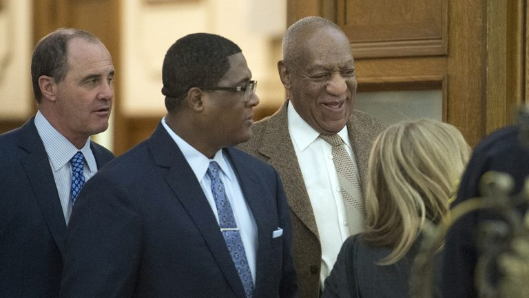 Bill Cosby leaves the courtroom with the help of an aide flanked by lawyer Brian McMonagle (far left) with fellow counsel Angela Agrusa (right) during a break at the Montgomery County Courthouse Wednesday in Norristown