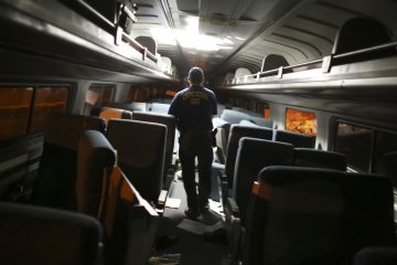 A crime scene investigator looks inside a train car after a train wreck, Tuesday, May 12, 2015, in Philadelphia. An Amtrak train headed to New York City derailed and crashed in Philadelphia.