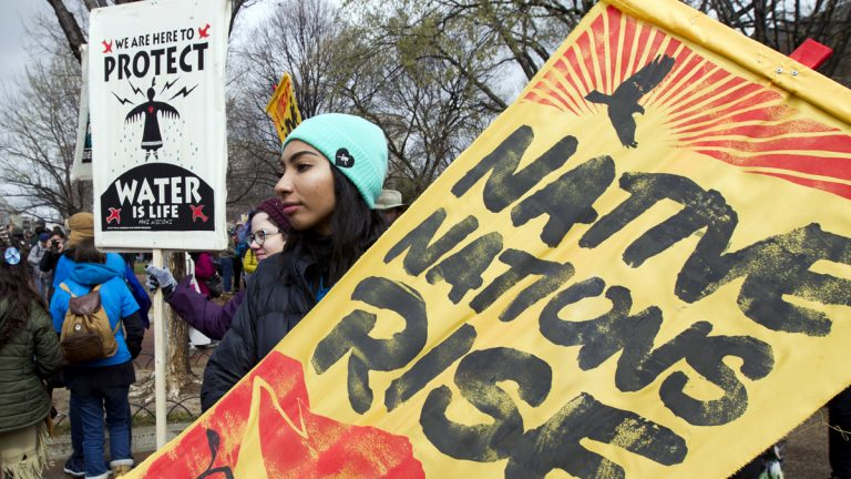 Demonstrators hold their banners during a protest outside of the White House, Friday, March 10, 2017, in Washington, to rally against the construction of the disputed Dakota Access oil pipeline. (Jose Luis Magana/AP Photo)