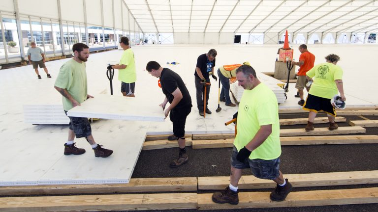 Workers assemble flooring last month in temporary structures outside the Wells Fargo Center ahead of the the 2016 Democratic National Convention in Philadelphia. (Matt Rourke/AP Photo)