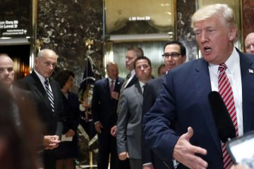 White House chief of staff John Kelly, (left), watches as President Donald Trump speaks to the media in the lobby of Trump Tower, Tuesday, Aug. 15, 2017 in New York. (Pablo Martinez Monsivais/AP Photo)