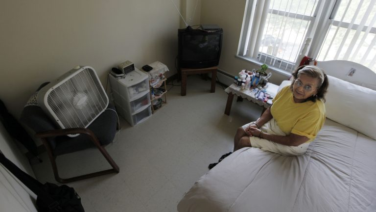 Tenant Virgina Mendoza stays cool with her fan and air conditioner, at her home in Apartamentos Las Americas during a well-being check by the Chicago Housing Authority Friday, July 6, 2012, in Chicago. (M. Spencer Green/AP Photo, file)