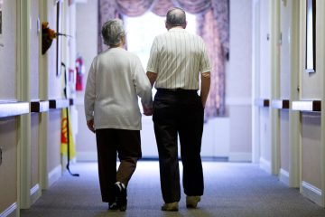 In this Nov. 6, 2015 file photo, an elderly couple walks down a hall in Easton, Pa. (Matt Rourke/AP Photo, File)