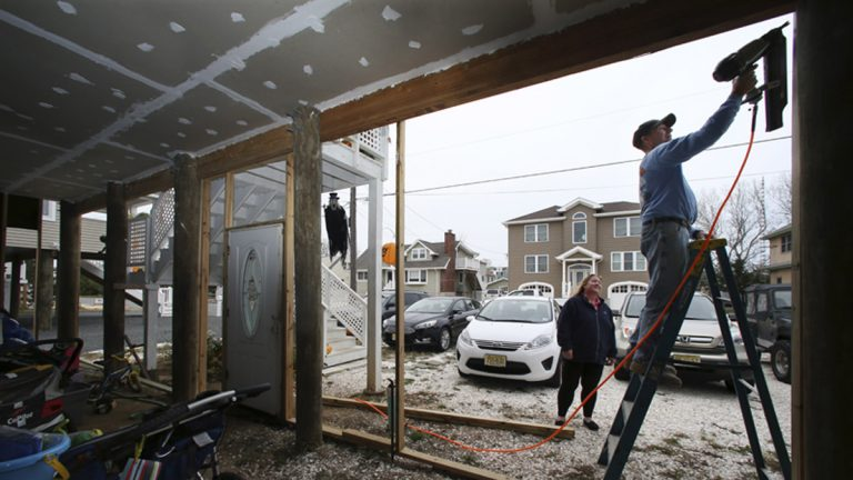 In October 2015,  a couple works on their home that has been raised since being damaged, with about 27 inches of water in their house during Superstorm Sandy, in Long Beach Township, N.J.  (Mel Evans/AP Photo)