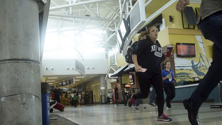 Passengers run for cover in Terminal 1 at Fort Lauderdale–Hollywood International Airport