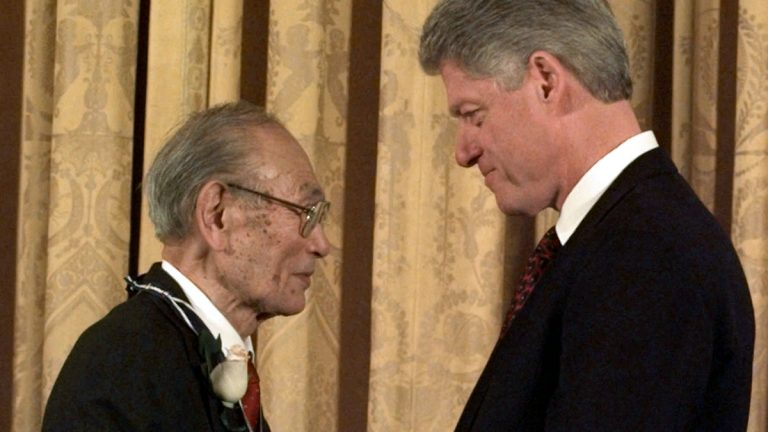 In this Jan. 15, 1998 file photo, President Clinton presents Fred Korematsu with a Presidential Medal of Freedom during a ceremony at the White House. On Thursday, May 20, 2010, the California state Assembly unanimously passed a bill designating Jan. 30 as Fred Korematsu Day of Civil Liberties and the Constitution in California. Korematsu, who died in 2005, was arrested in Oakland in 1942 after refusing to enter an internment camp. His case led the U.S. Supreme Court to examine the internment order's legality. (Dennis Cook/AP Photo, file)