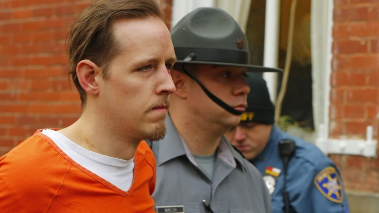 Eric Frein is escorted by police out the Pike County Courthouse after his arraignment in Milford, Pa., Friday Oct. 31, 2014. Frein, was captured seven weeks after police say he killed a Pennsylvania State trooper in an ambush outside a barracks in Northeastern Pennsylvania. (Rich Schultz/AP Photo)