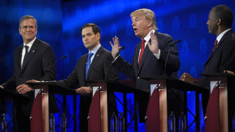 Donald Trump, (second from right), speaks as Jeb Bush, (left), Marco Rubio, (second from left), and Ben Carson look on during the CNBC Republican presidential debate at the University of Colorado in Boulder, Colorado. (Mark J. Terrill/AP Photo)