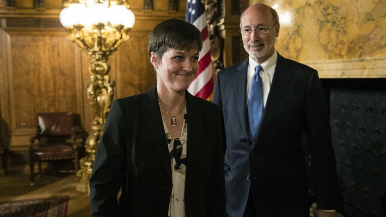 Teresa Miller accompanied by Gov. Tom Wolf depart a news conference at the Pennsylvania Capitol in Harrisburg, Pa., Tuesday, May 23, 2017. Wolf says he'll nominate his insurance commissioner, Miller, to lead a new agency overseeing public health and human services programs. (Matt Rourke/AP Photo)