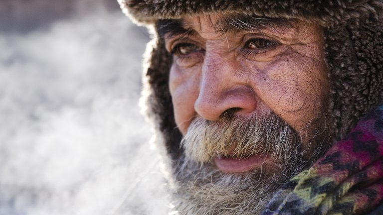 A homeless man comes in out of the cold after speaking with an outreach worker (Matt Rourke/AP Photo)