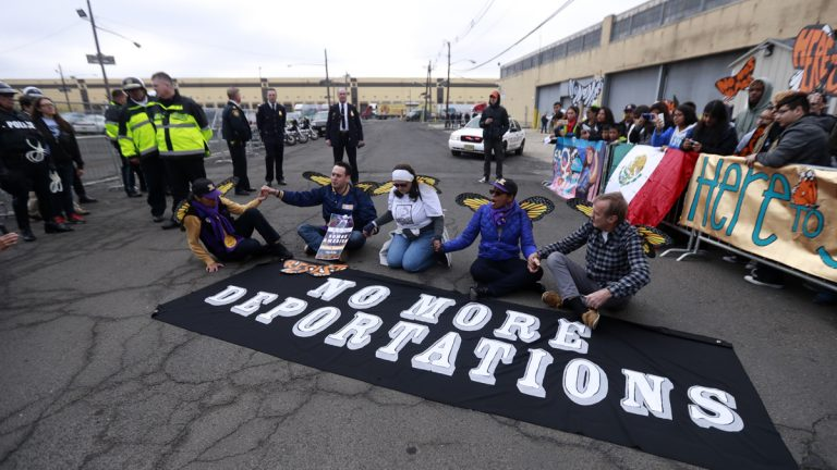 Activists block a street as police officers look on during an immigration protest outside of a detention center, Thursday, Feb. 23, 2017, in Elizabeth, N.J. (Julio Cortez/AP Photo)