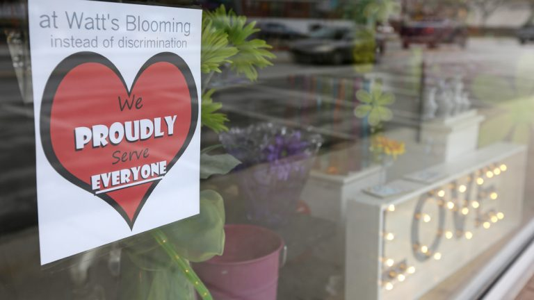 A window sign on a downtown Indianapolis florist, Wednesday, March 25, 2015, shows it's objection to the Religious Freedom bill passed by the Indiana legislature. Organizers of a major gamers' convention and a large church gathering say they're considering moving events from Indianapolis over a bill that critics say could legalize discrimination against gays. (Michael Conroy/AP Photo)