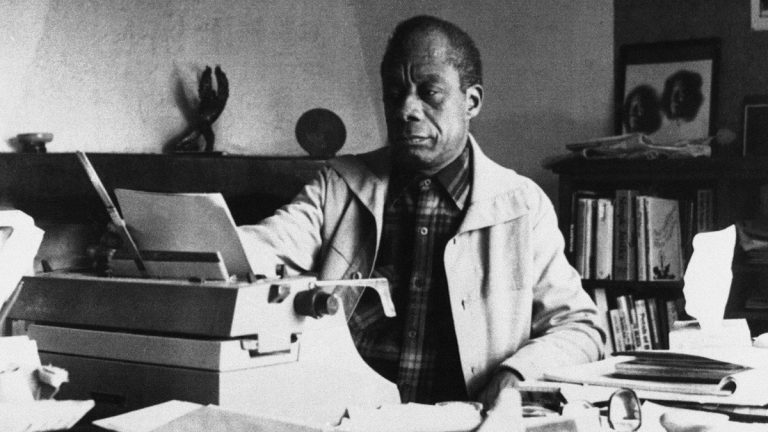 American writer James Baldwin poses in front of his typewriter in his house, March 15, 1983, Saint Paul de Vence, France. (Photo Pressenia/AP Photo)