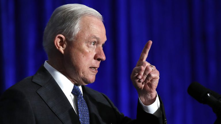 In this June 21, 2017 file photo, Attorney General Jeff Sessions speaks in Bethesda, Md. Sessions is visiting the Guantanamo Bay detention facility, which he has called a fine place to house new terrorism suspects. (Jacquelyn Martin/AP Photo, File)
