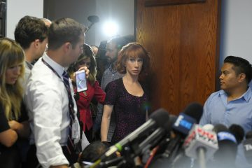 Comedian Kathy Griffin enters a room packed with reporters for a news conference, Friday, June 2, 2017, in Los Angeles to discuss the backlash since Griffin released a photo and video of her displaying a likeness of President Donald Trump's severed head. (Mark J. Terrill/AP Photo)