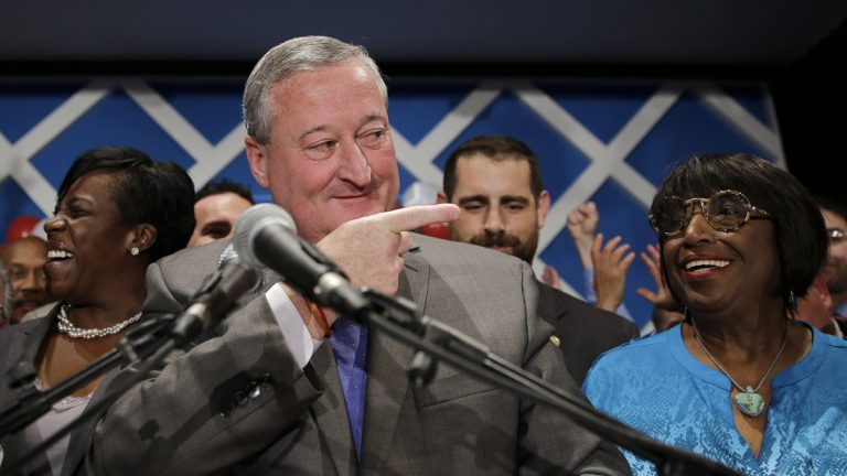 Democratic mayoral candidate and former City Councilman Jim Kenney, center, gestures onstage after winning the primary election, Tuesday, May 19, 2015, in Philadelphia. The former longtime Philadelphia councilman with broad union backing is poised to become the next mayor of the nation's fifth largest city after his resounding win Tuesday in a six-way Democratic primary. (Matt Slocum/AP Photo)