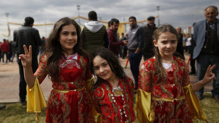 Children in traditional Kurdish clothing, pose for the photographer during the Newroz celebration, in Diyarbakir, southeastern Turkey, Tuesday, March 21, 2017. Thousands celebrated the Newroz festival in Istanbul and in Diyarbakir, a mainly Kurdish city in a region where Kurdish militants regularly clash with government forces. In Turkey, the spring festival traditionally serves as an occasion to demand more rights for the Kurdish minority.(Lefteris Pitarakis/AP Photo)
