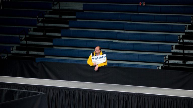 A member of the audience stands alone after a rally for Republican presidential candidate Donald Trump at Sumter Country Civic Center in Sumter, S.C., Wednesday, Feb. 17, 2016. (AP Photo/Andrew Harnik)