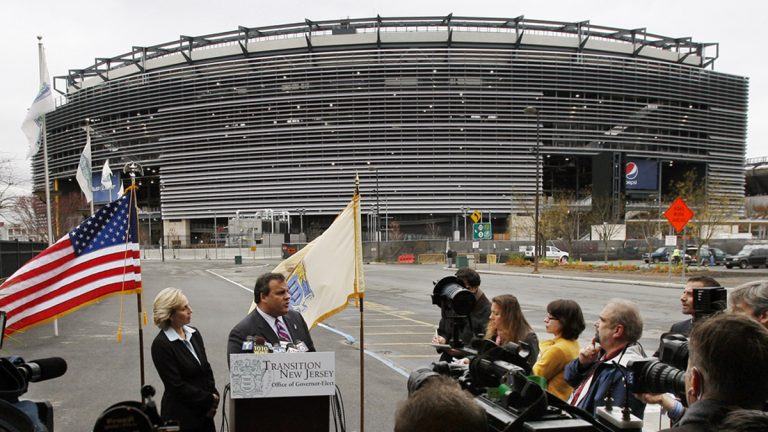 In this Nov. 13, 2009, file photograph, New Jersey's Lt. Gov. Kim Guadagno, (left), listens as Gov. Chris Christie answers a question outside the Meadowlands stadium in East Rutherford, N.J. (Mel Evans/AP File Photo)